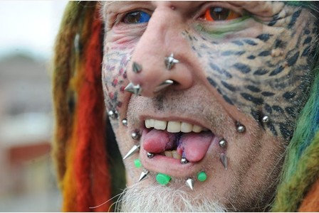 Ted Richards, known as Parrot Nan in the local community prides himself on body modification. It is believed he had now become the first person in the world to have 5 implants in his face including two horns. He has also had his eyes dyed and tongue split. Date: 17/06/15 Photographer: Simon Galloway/Staff. Copyright: Local World