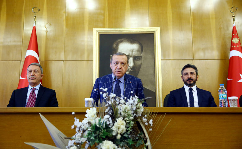 Turkish President Tayyip Erdogan, accompanied by Chief of Staff General Hulusi Akar and deputy Parliament Speaker Ahmet Aydõn, speaks during a news conference at Ataturk International airport in Istanbul, Turkey, January 28, 2017. Kayhan Ozer/Presidential Palace/Handout via REUTERS ATTENTION EDITORS - THIS PICTURE WAS PROVIDED BY A THIRD PARTY. FOR EDITORIAL USE ONLY. NO RESALES. NO ARCHIVE.