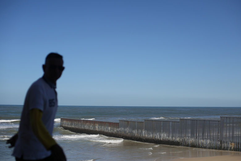 A man is seen near a section of the wall separating Mexico and the United States, in Tijuana, Mexico, March 6, 2017. REUTERS/Edgard Garrido